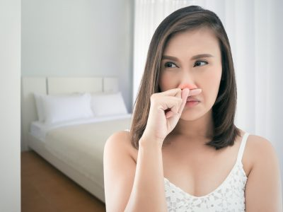 Asian women in white dress feeling unwell and sneeze at bedroom, Dust allergies symptoms, People caught cold and allergy